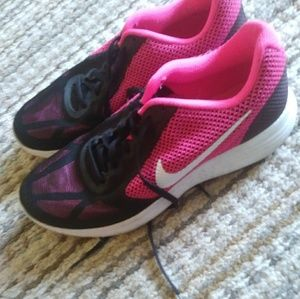Nike athletic shoes. Pink and black.womens